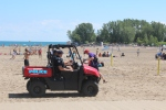 Beach volleyball patrol. Tough assignment for the OPP.