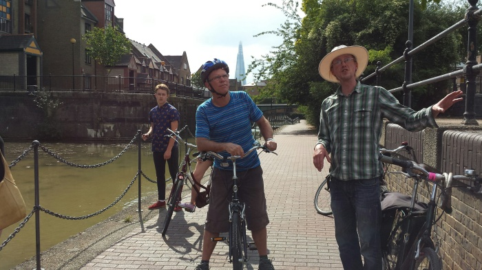 Mathew Tregaron (right) of Cycle Tours of London stops for a breather at deserted Tobacco Dock.